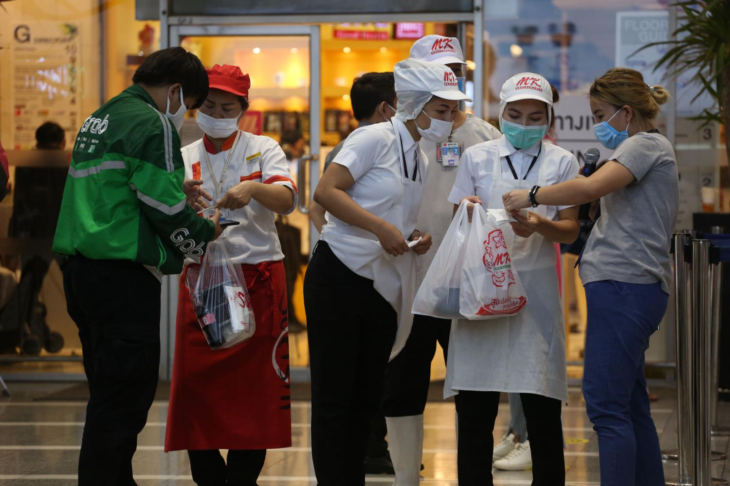 Restaurants at The Mall Bang Kapi see a rise in home delivery orders after their dining zones were ordered closed for 22 days as part of the government's efforts to contain the spread of the new coronavirus outbreak.Varuth Hirunyatheb