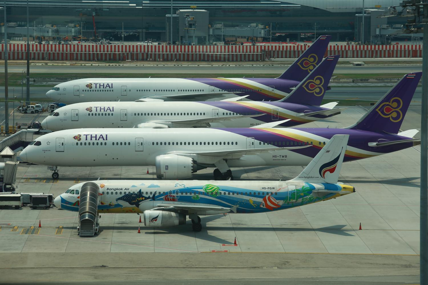 The Civil Aviation Authority of Thailand has okayed airlines' decision to scale back flights or stop flying due to the Covid-19 outbreak. (Photo by Somchai Poomlard)