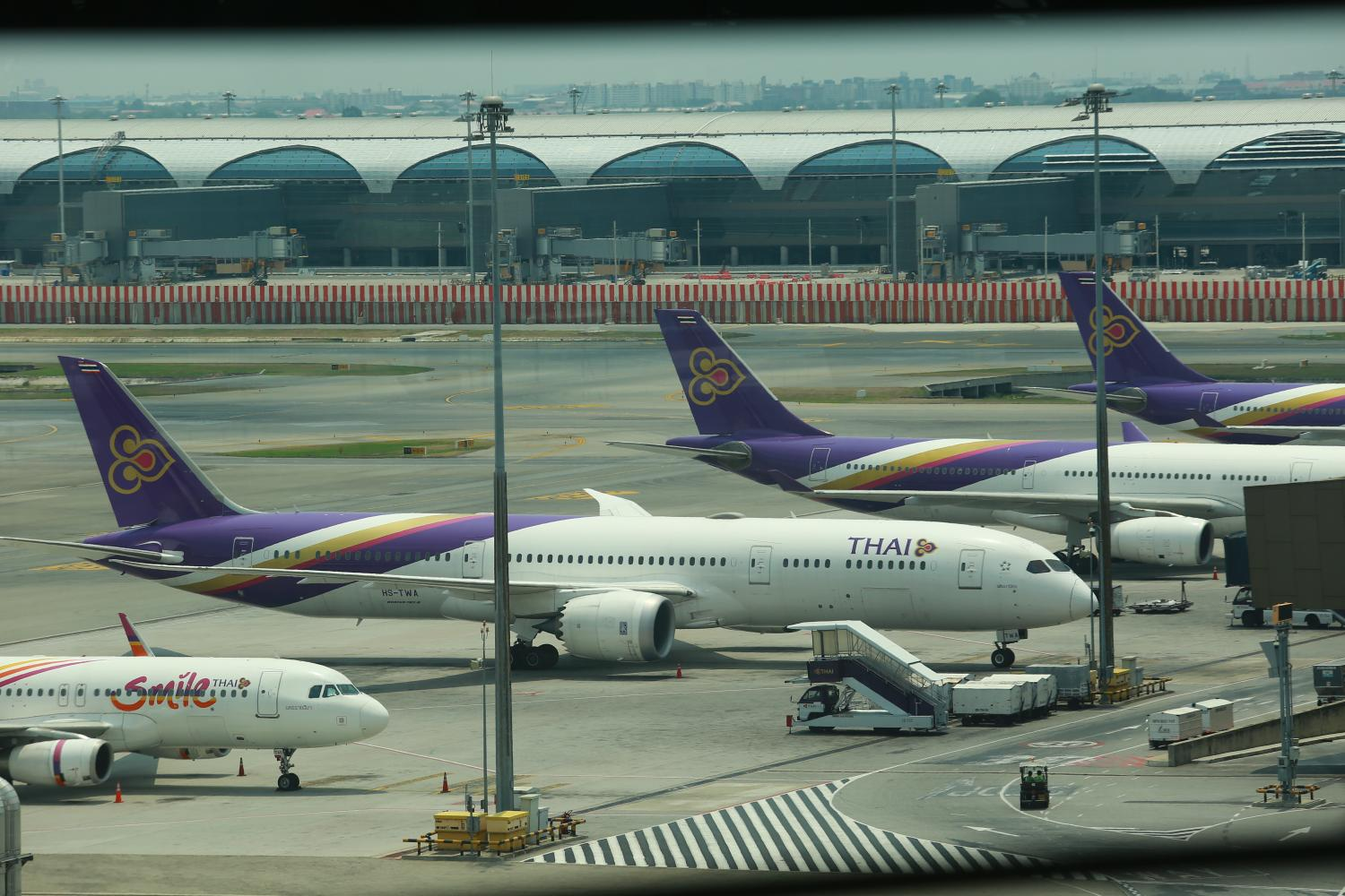 THAI aeroplanes parked at Suvarnabhumi airport. With tourism at a standstill, operators are anxious for aid.(Photo by Somchai Poomlard)