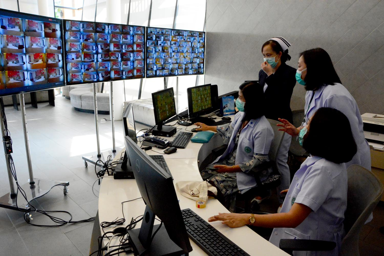 Keeping an eye out: Thammasat University's Hospital opens its first field hospital converted from a dormitory on its Rangsit campus. Patients will be confined to their rooms and monitored on CCTV by the medical team.