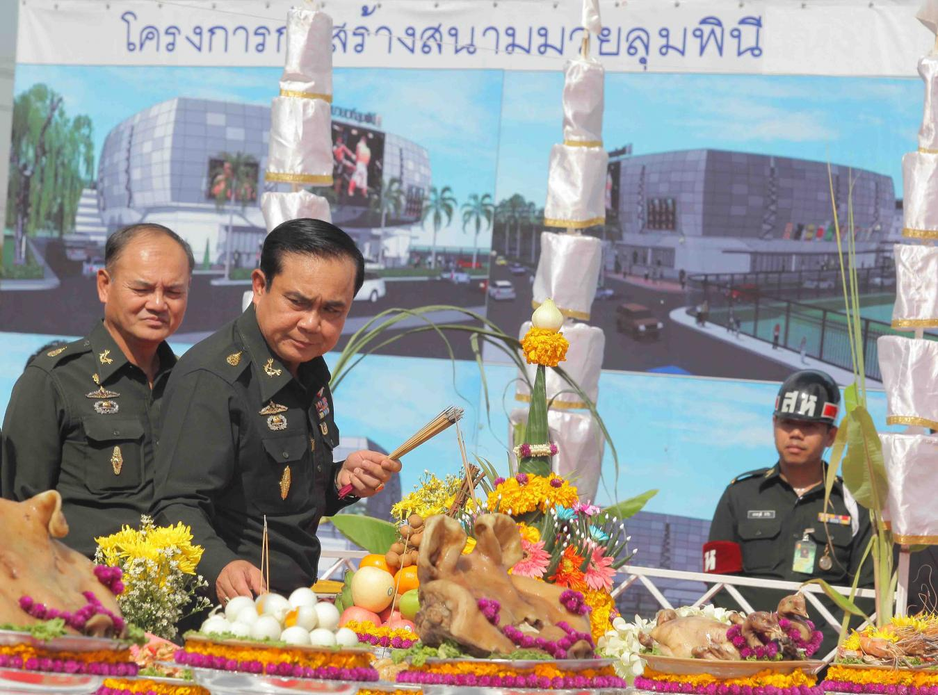 Gen Prayut Chan-o-cha, then army chief and executive director of the Lumpinee Boxing Stadium, lays foundation stones at the construction site of the new stadium on Ram Intra Road in Bangkok in August 2012. PATTANAPONG HIRUNARD