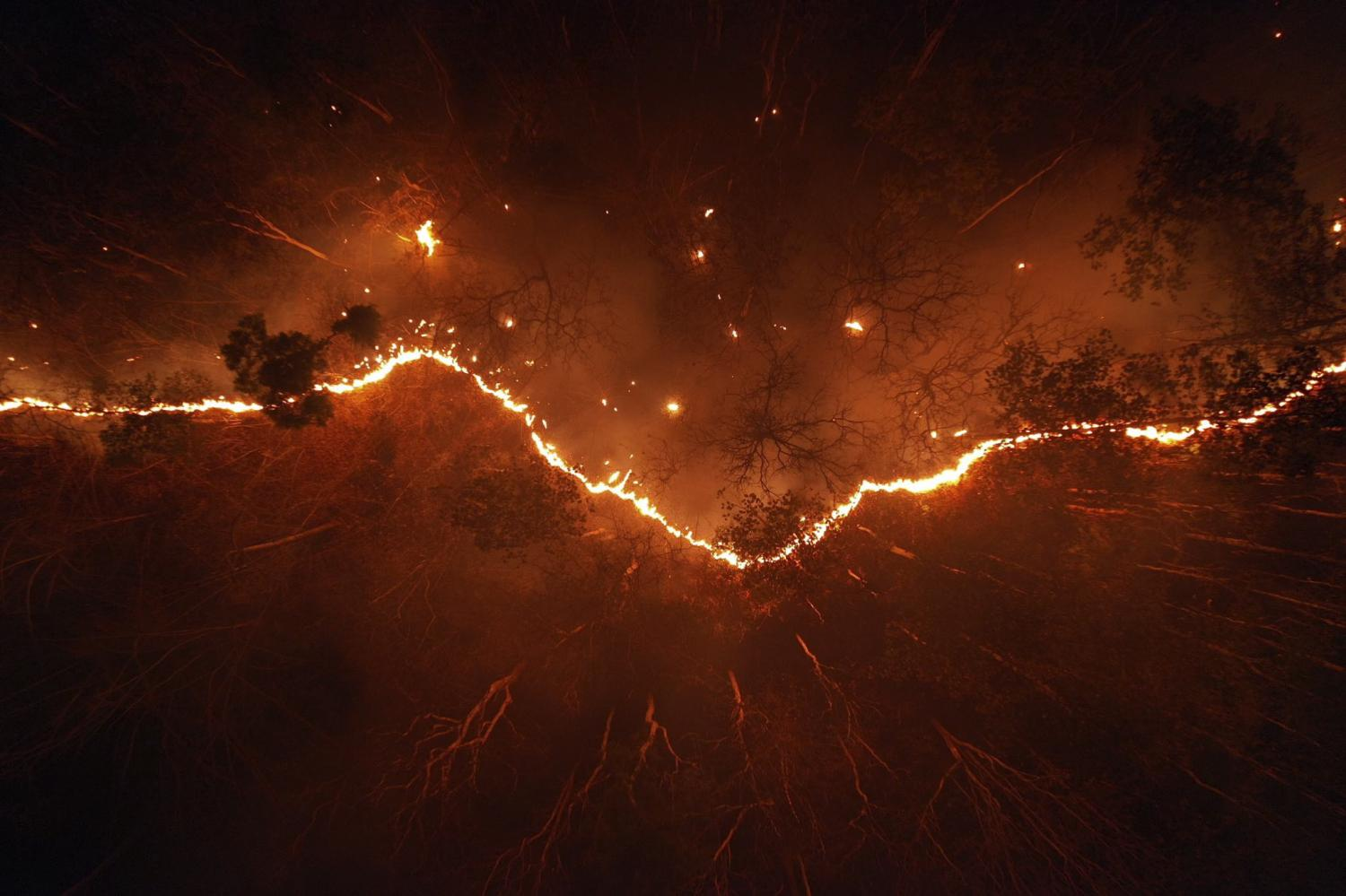 A huge fire engulfs part of a Chiang Mai forest on the night of March 25.(Chiang Mai Volunteer Drone Team)
