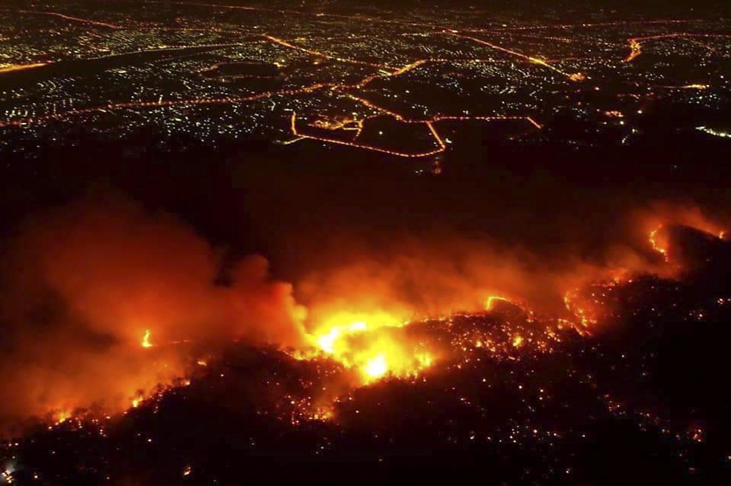 A bushfire ravages Doi Suthep-Pui National Park in Chiang Mai's Hang Dong district on the night of March 25. (Chiang Mai Volunteer Drone Team)