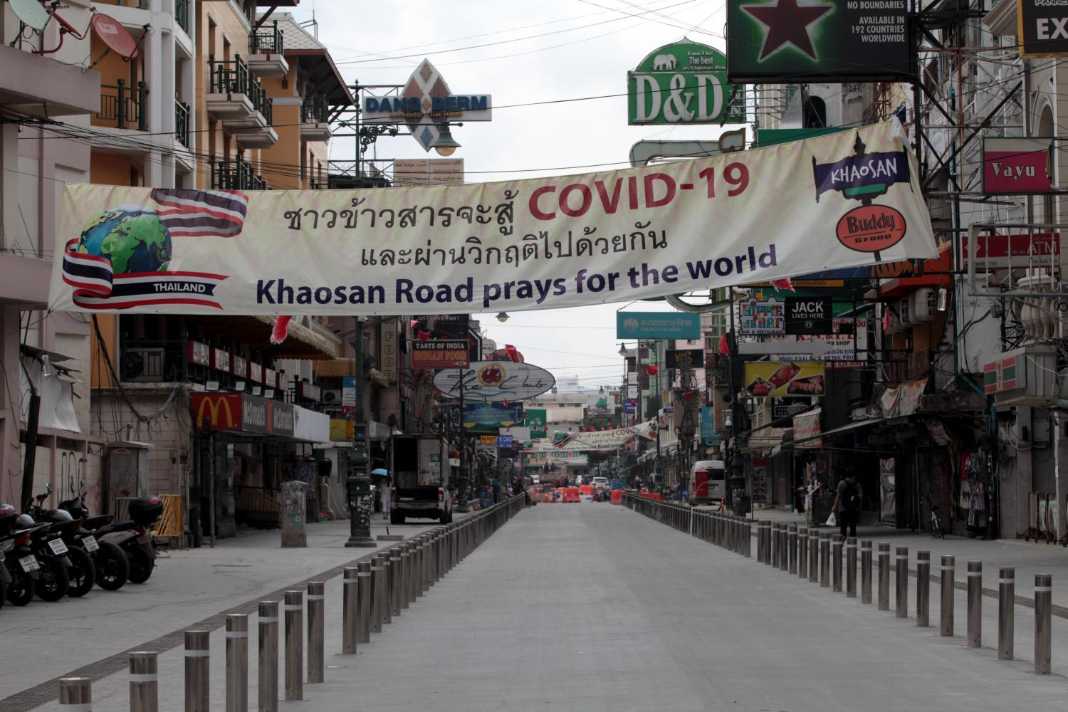 A sign has gone up at deserted Khao San Road as the prolonged coronavirus crisis leads to economic stagnation around the world. Chanat Katanyu