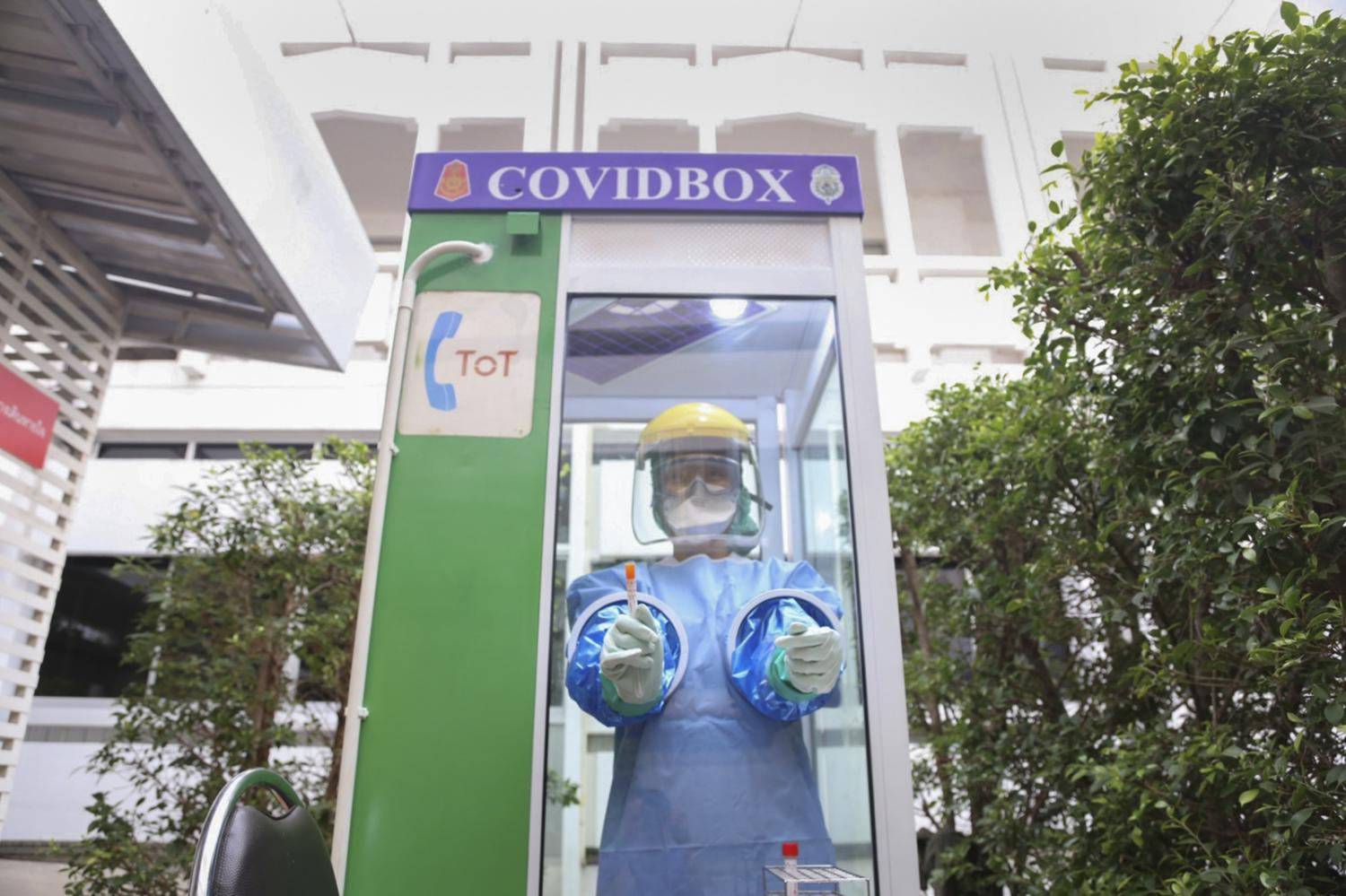 A TOT phone booth transformed into a makeshift Covid box for testing. The kiosk wards off the infection risk among healthcare workers.