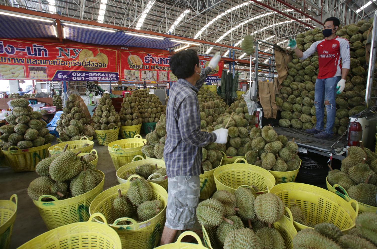 Fresh durian is loaded into a Thong Fah mobile fruit store. There are 350 such stores across Bangkok.