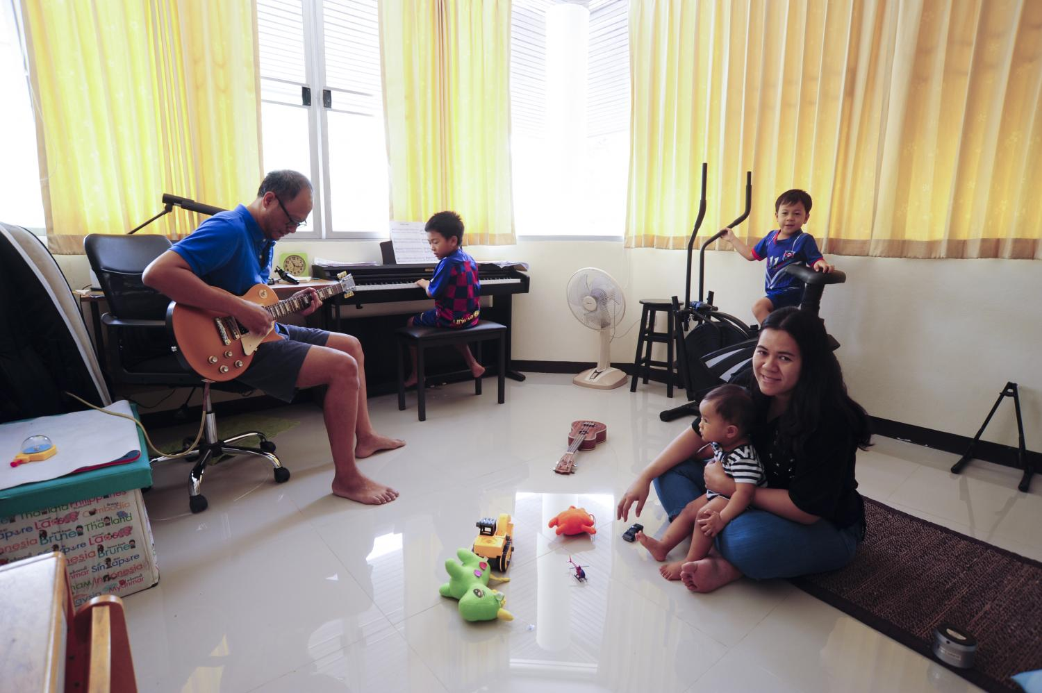 QUALITY TIME: Dawee Chaikere, 39, and her husband, spend time with their three children at their home in Nonthaburi during their stay at home to help contain the outbreak of Covid-19. She admits that it is a challenge to find activities to keep three young sons happy, busy and learning at the same time.