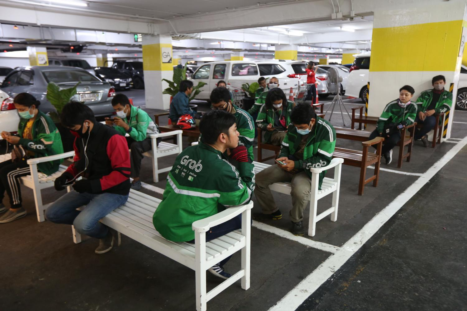Delivery drivers for GrabFood wait to receive orders from restaurants at The Mall Bang Kapi.(Photo b Varuth Hirunyatheb)
