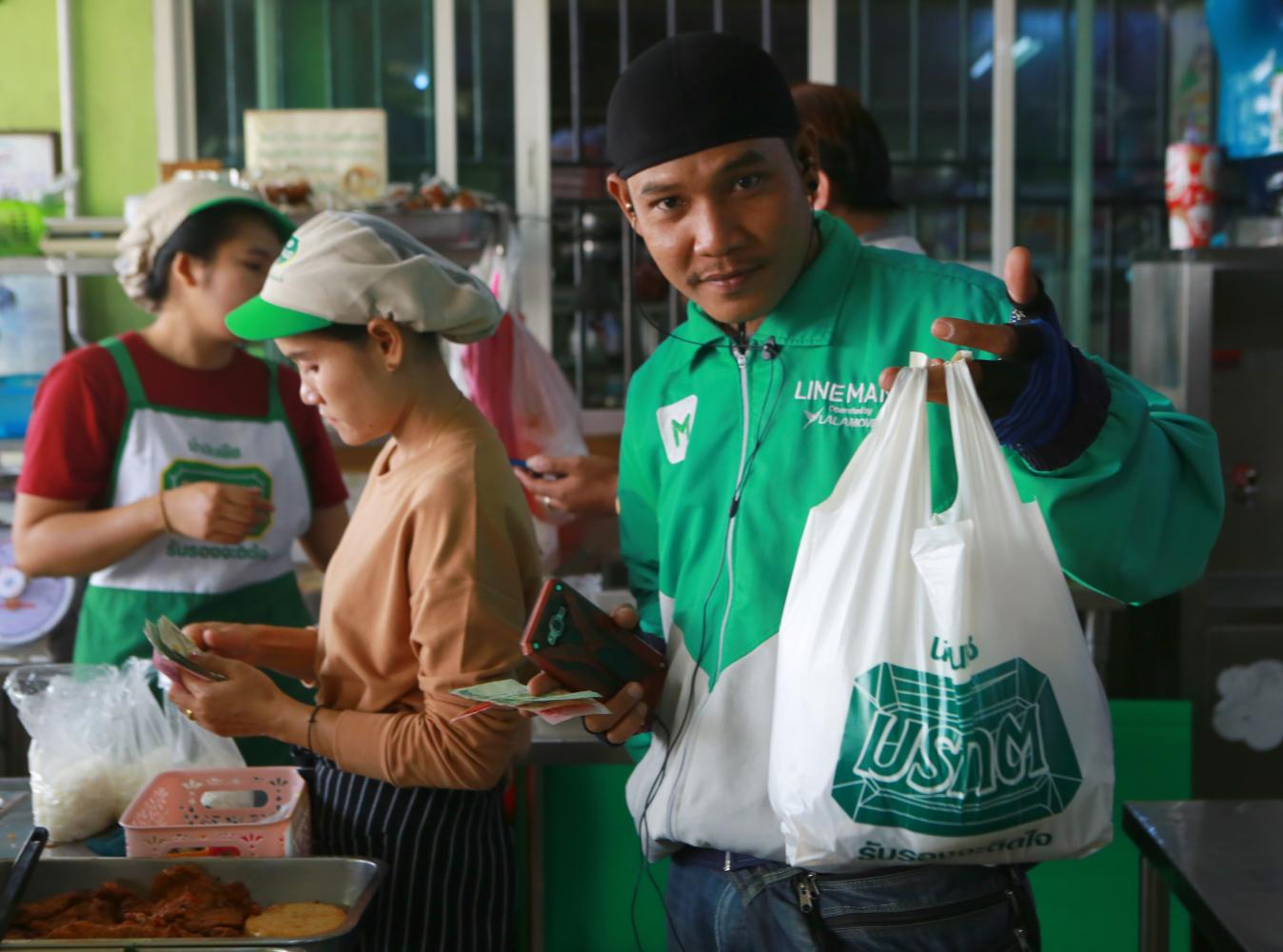 Single-use plastic bags are seeing a comeback as restaurants turn to home deliveries. Somchai Poomlard