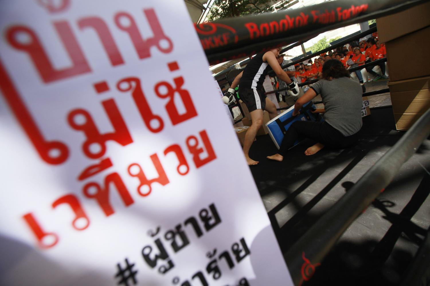 Activists conduct a campaign against domestic violence in Bangkok. (Photo by Pornprom Satrabhaya)