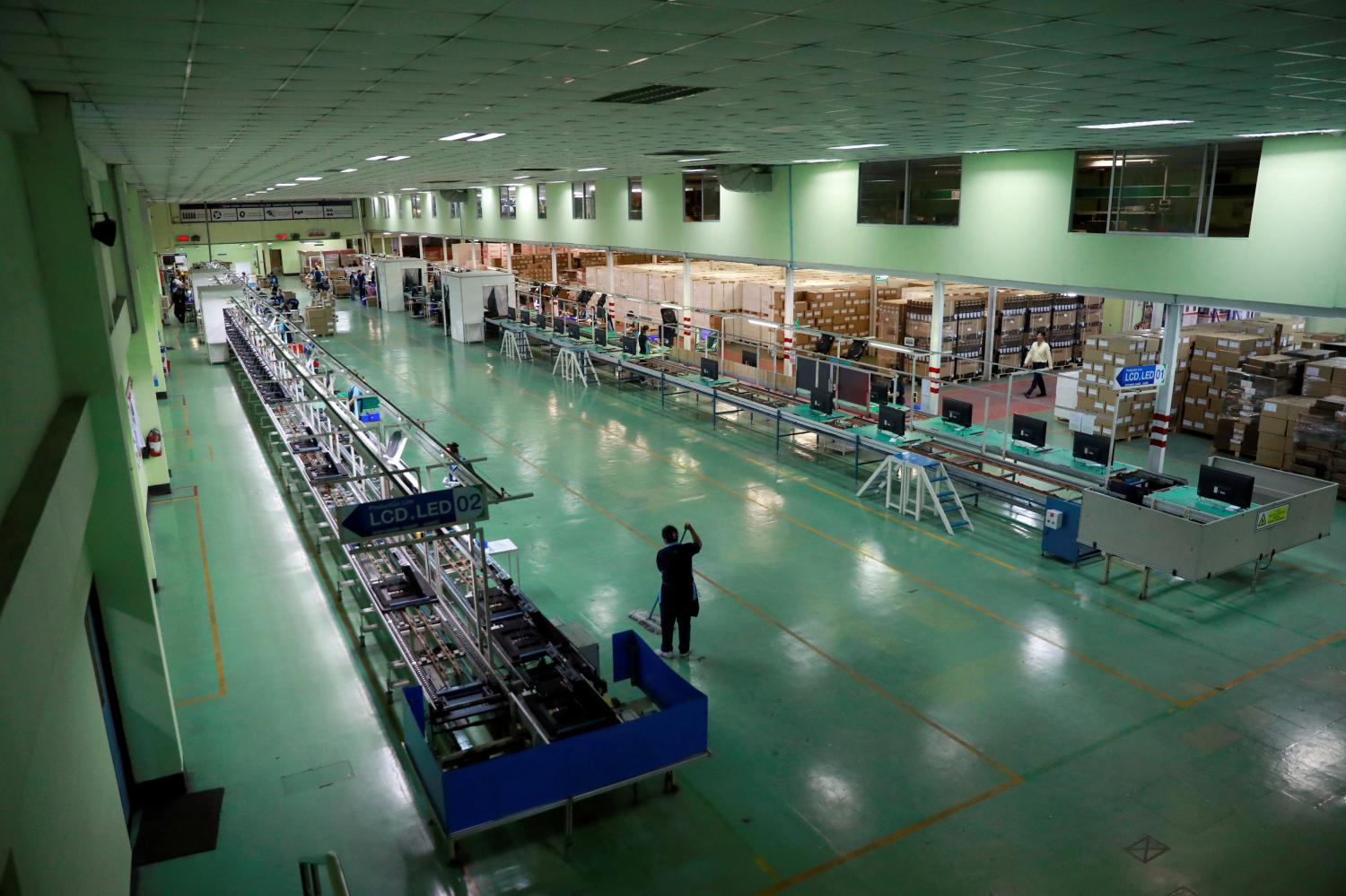 A TV assembly line is virtually abandoned in Bangkok as the OIE downgrades to MPI to as low as -7%. REUTERS
