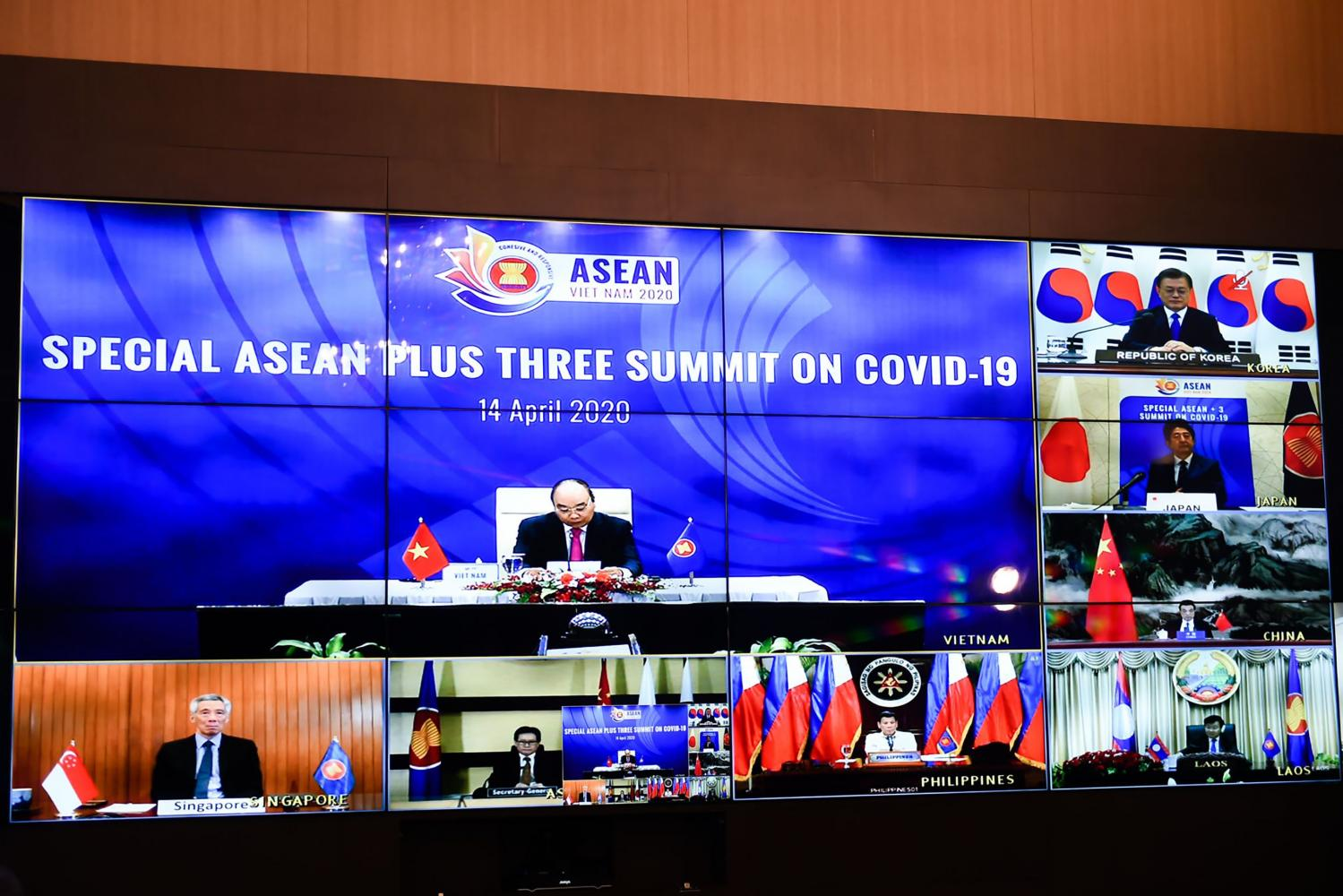 Multiple screens of a live video conference are seen at the special Association of Southeast Asian Nations Plus Three Summit on the Covid-19 coronavirus pandemic held in Hanoi.(AFP)