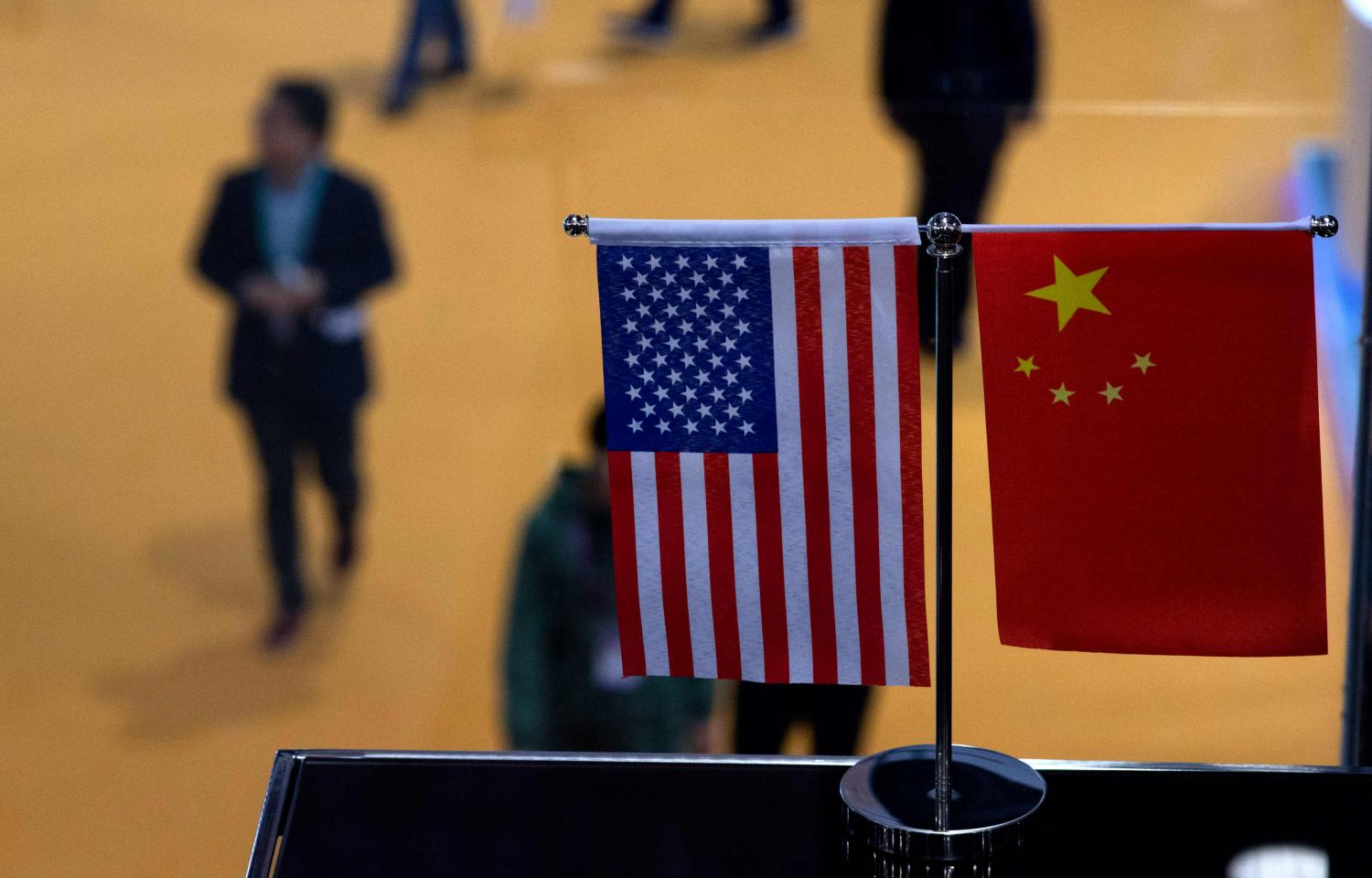 In this file photo taken on Nov 6, 2018 a Chinese and US flag are displayed at a booth during the first China International Import Expo in Shanghai.AFP