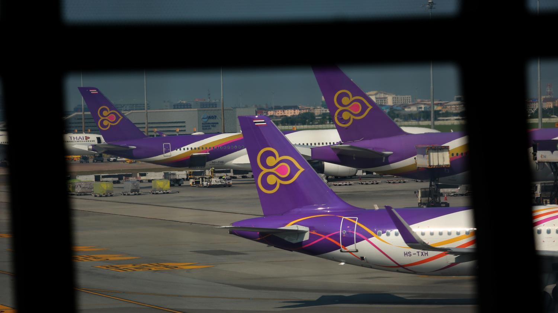 A fleet of Thai Airways International aircraft are parked at Suvarnabhumi airport.Somchai Poomlard