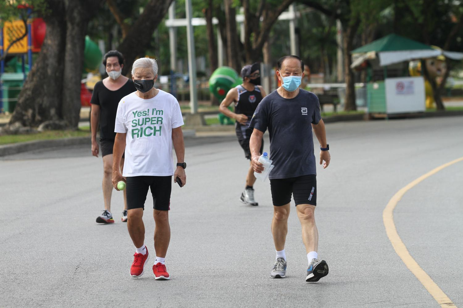 People wear face masks while out for a morning jog in Lumpini Park. City Hall has warned it might close parks again, after re-opening them on May 3, as many people are ignoring social distancing rules.(Photo by Nutthawat Wicheanbut)
