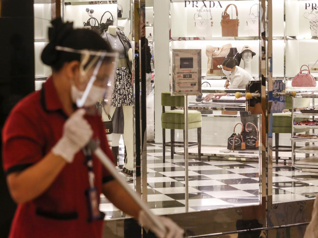 The Prada store at Siam Paragon prepares to reopen after a long lockdown.