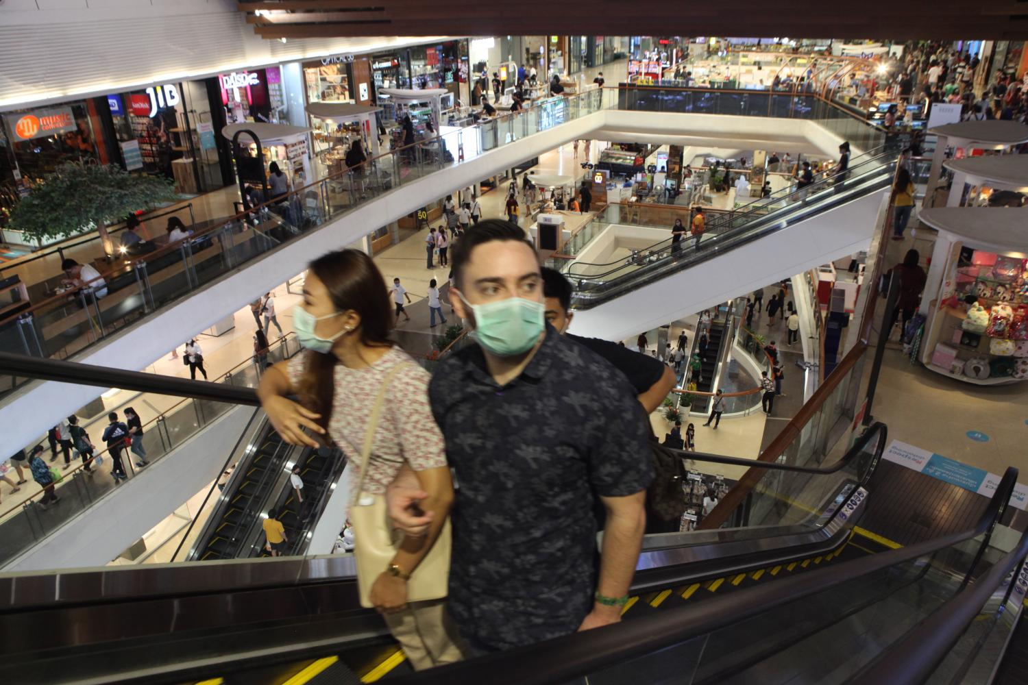 Shoppers at Central Lat Phrao observe social distancing measures by wearing face masks and keeping distance from strangers. (Photo by Arnun Chonmahatrakool)