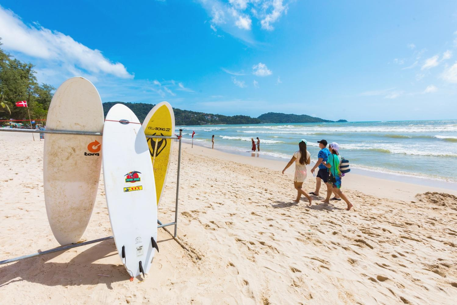 Tourists stroll at Patong Beach, Phuket. The island may be among the first to welcome international tourists under the 'Amazing Trusted Thailand' campaign.