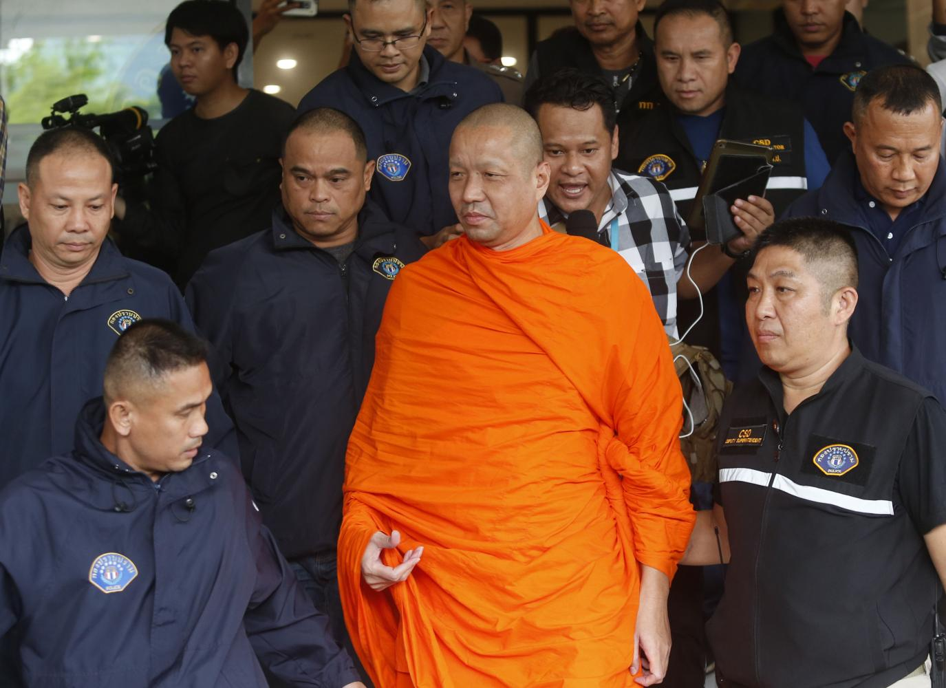Methi Sutthikon, then assistant abbot of Wat Sa Ket, is brought to police custody in Bangkok in May 2018. (Bangkok Post file photo)
