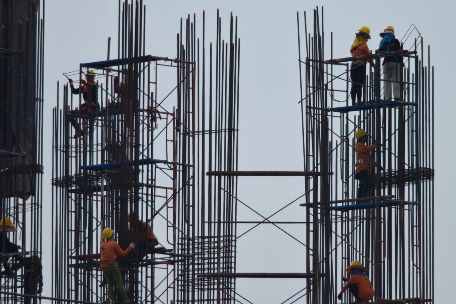 Workers assemble steel rods at a construction site in Bangkok.Panumas Sanguanwong