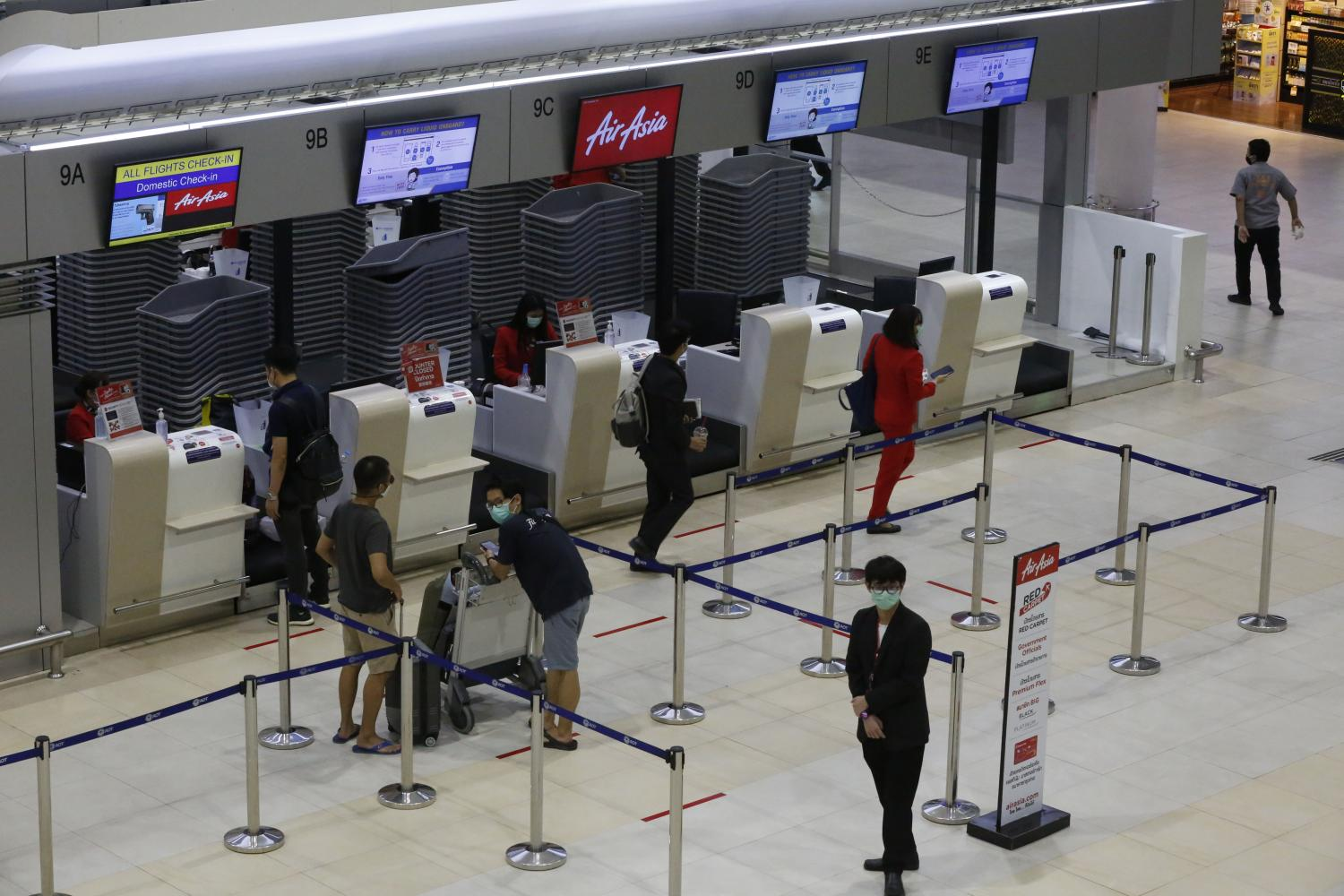 Local travellers at the check-in counter at Don Mueang airport. Tourism officials expect domestic travel to kick-start by June. (Photo by Pornprom Satrabhaya)