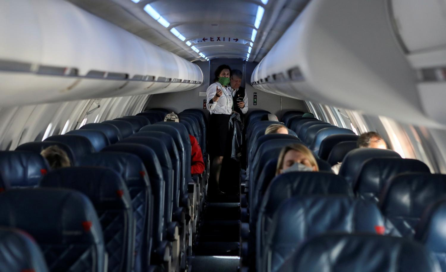 Airlines are trying to reassure passengers that masks and filtered cabin air provide reliable protection from infection in flight.(Reuters)