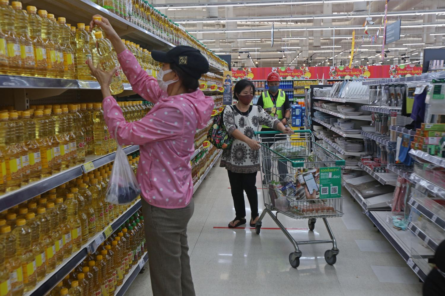 Consumers browse goods at a Tesco Lotus hypermarket. Varuth Hirunyatheb
