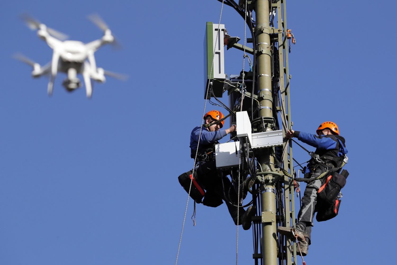 Engineers install Ericsson 5G equipment in Switzerland. Bloomberg