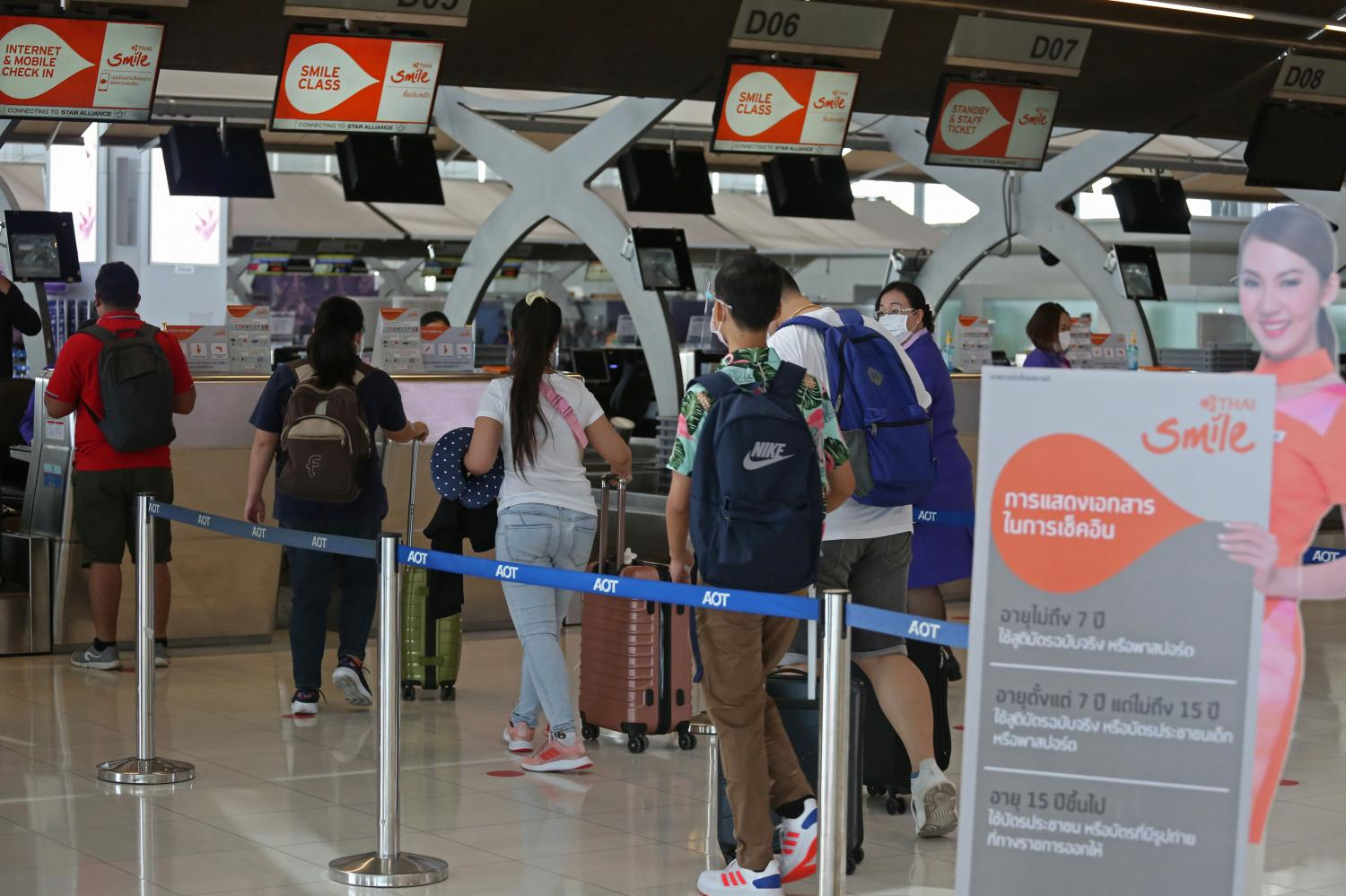 Passengers check in at THAI Smile's counter at Suvarnabhumi airport. The airline has resumed domestic flights to 10 destinations.