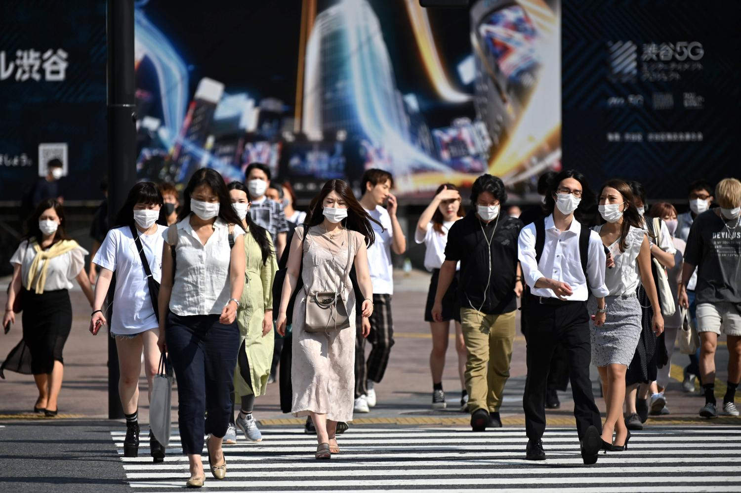 People tread Shibuya crossing in Tokyo on Monday. The FTI is forwarding a request for 100 Japanese business travellers per day be allowed in the country. AFP