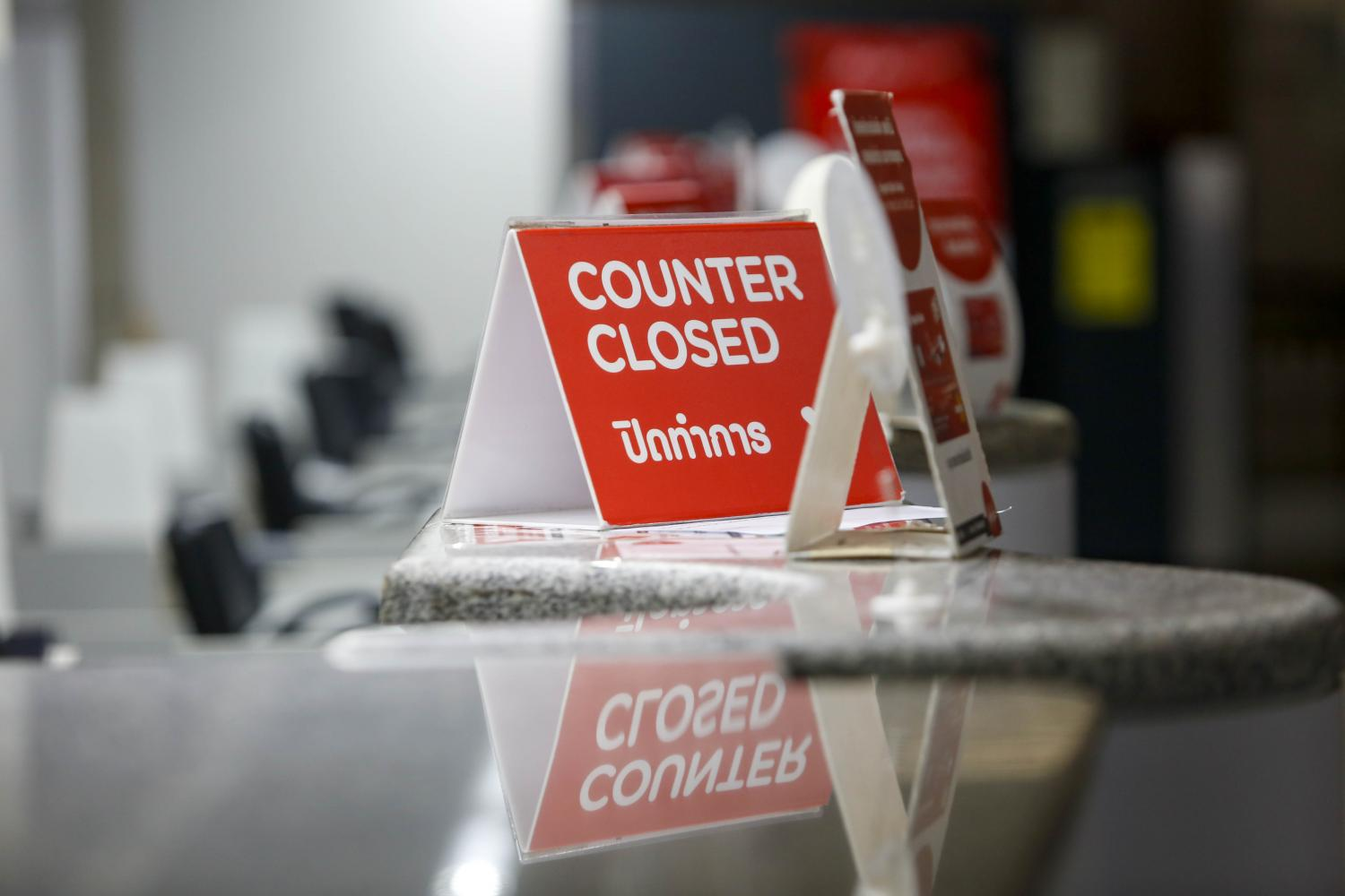 Airline check-in counters remain closed amid travel restrictions. Thailand's economic downturn has been aggravated by supply chain disruptions and global aviation curbs during the pandemic.Pattarapong Chatpattarasill