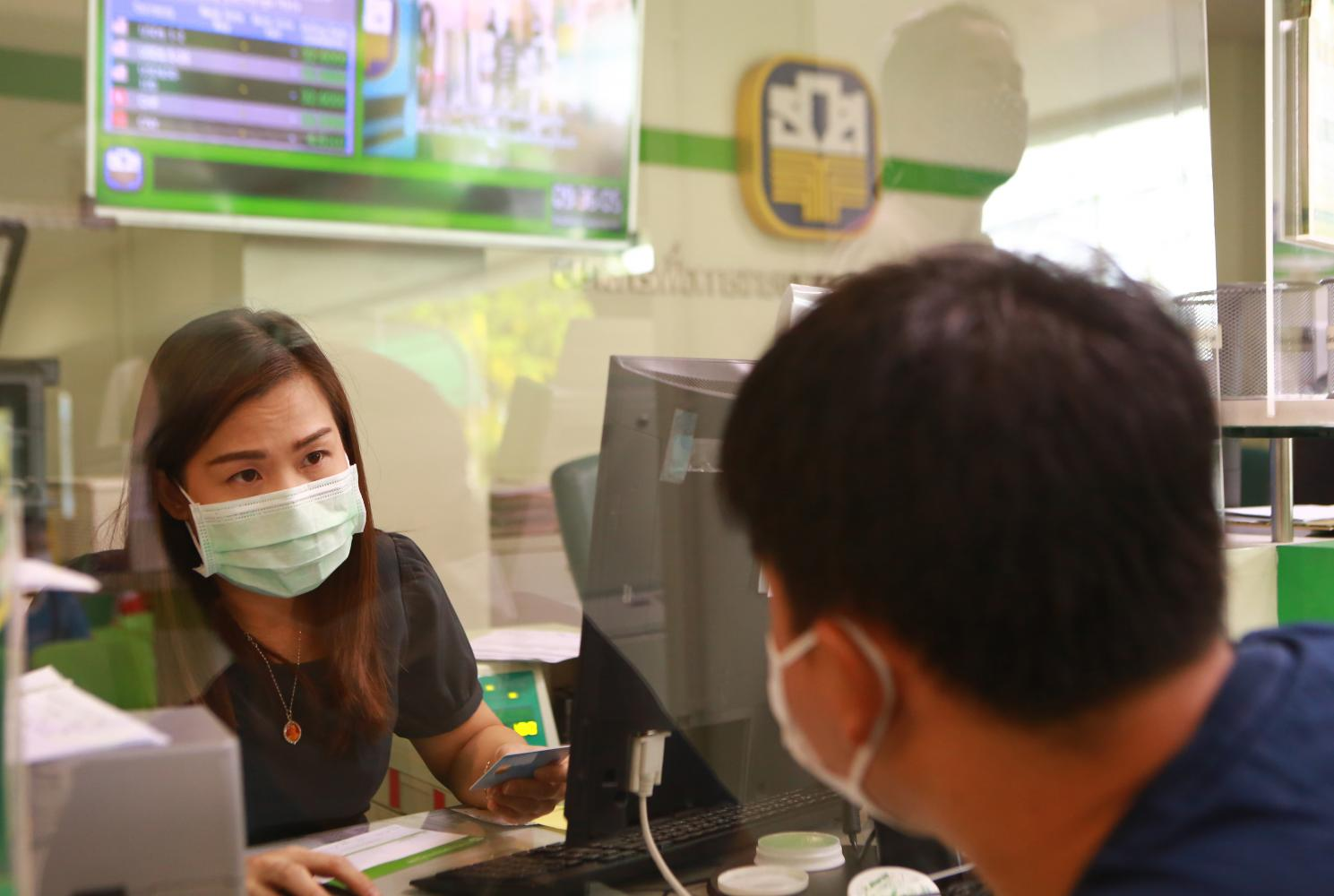 A farmer seeks a loan at a branch of the Bank for Agriculture and Agricultural Cooperatives.Somchai Poomlard