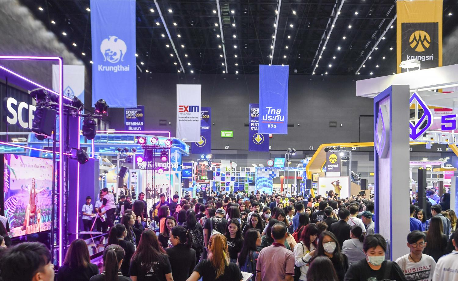 Customers browse financial services at a Money Expo. The banking industry has been focusing on helping customers via several methods of debt restructuring.