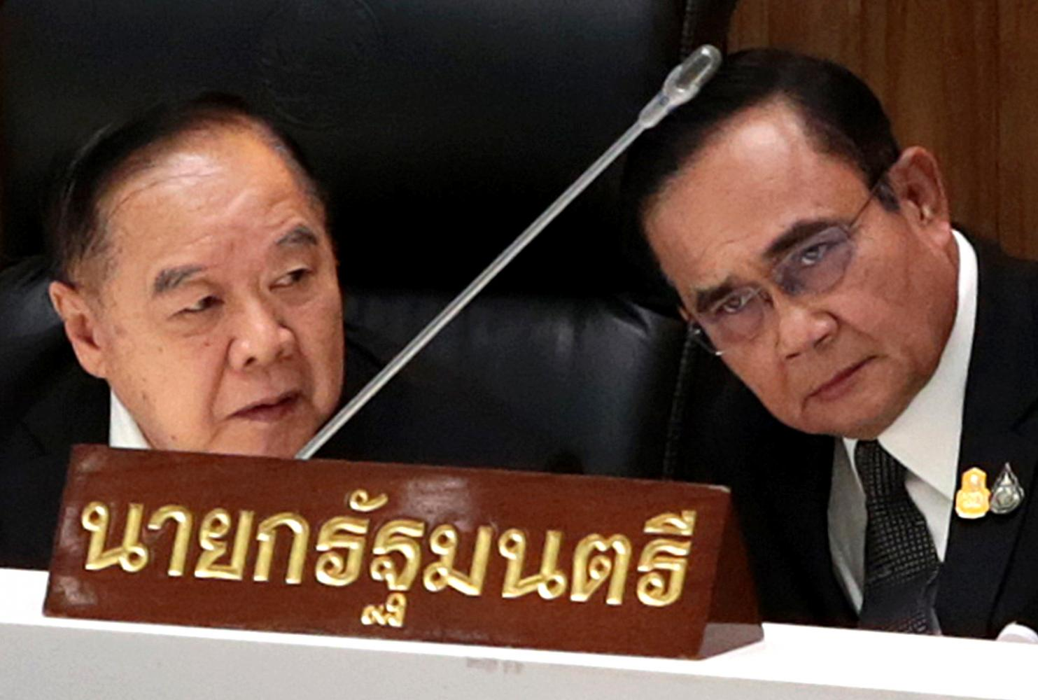 In this file photo, Prime Minister Prayut Chan-o-cha and his deputy, Gen Prawit Wongsuwon, put their heads together as they discuss issues during the no-confidence debate in February.Chanat Katanyu