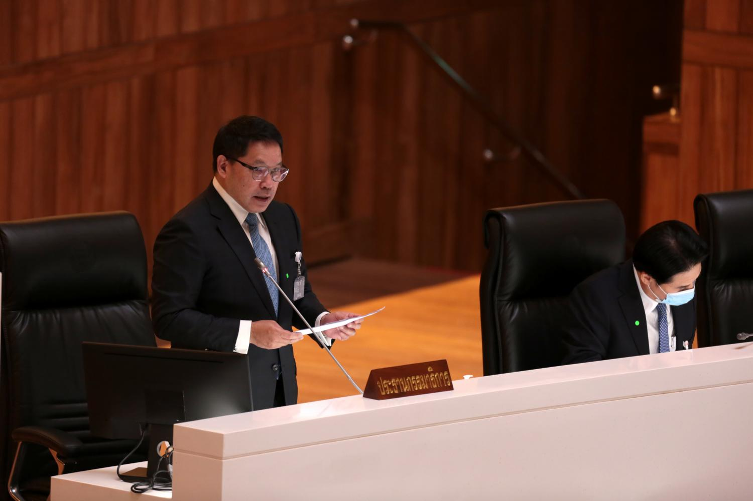 Finance Minister Uttama Savanayana addresses the House yesterday on a bill transferring annual budgets from agencies to subsidise the state's handling of the Covid-19 pandemic. Chanat Katanyu