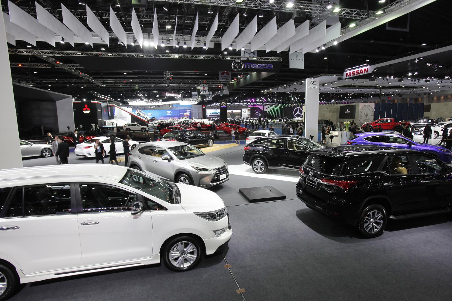 Cars on display at a motor show. The private sector is urging the state to speed up measures to aid car makers. (Bangkok Post photo)