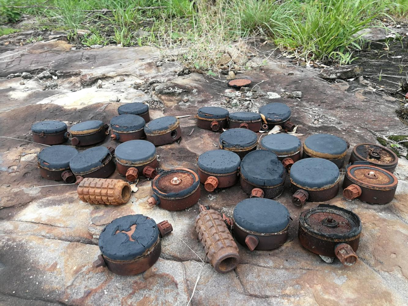 Types of landmines are seen that have been found on Hill 500.TMAC