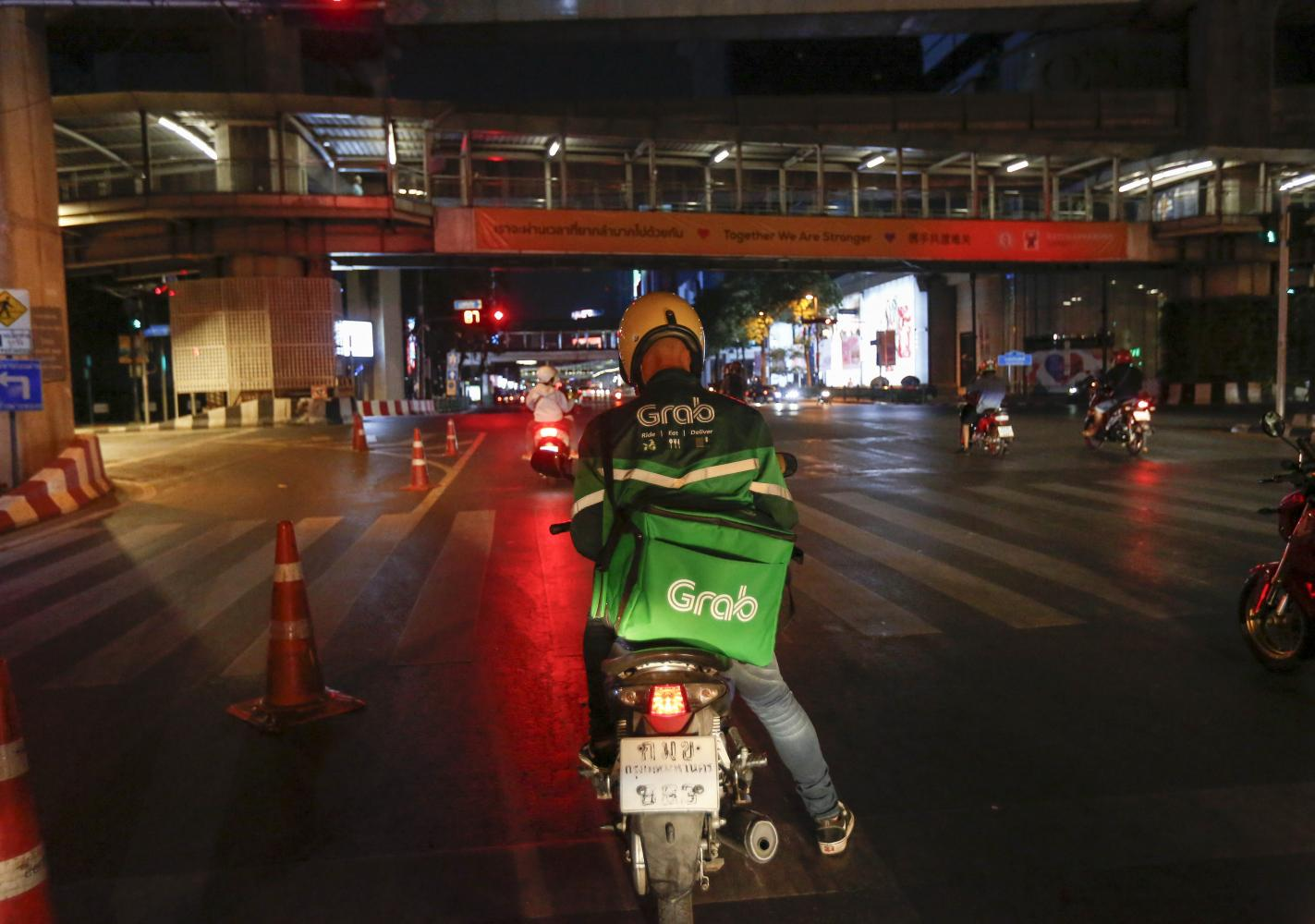 A GrabFood rider making deliveries during lockdown. Pattarapong Chatpattarasill