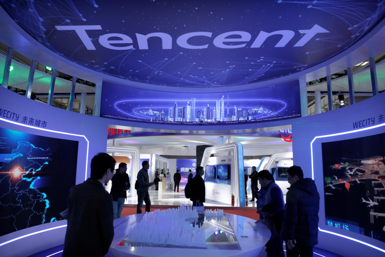 People visit Tencent's booth at the World 5G Exhibition in Beijing. The company just acquired Iflix streaming service. REUTERS