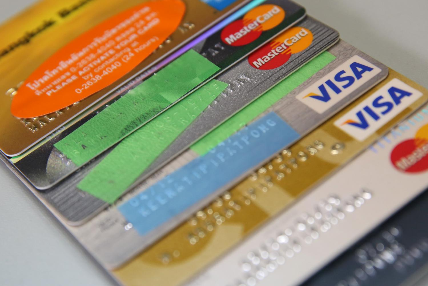 Banks have cut interest rates for credit cards to help millions of people facing financial stress. (Photo by Varuth Hirunyatheb)