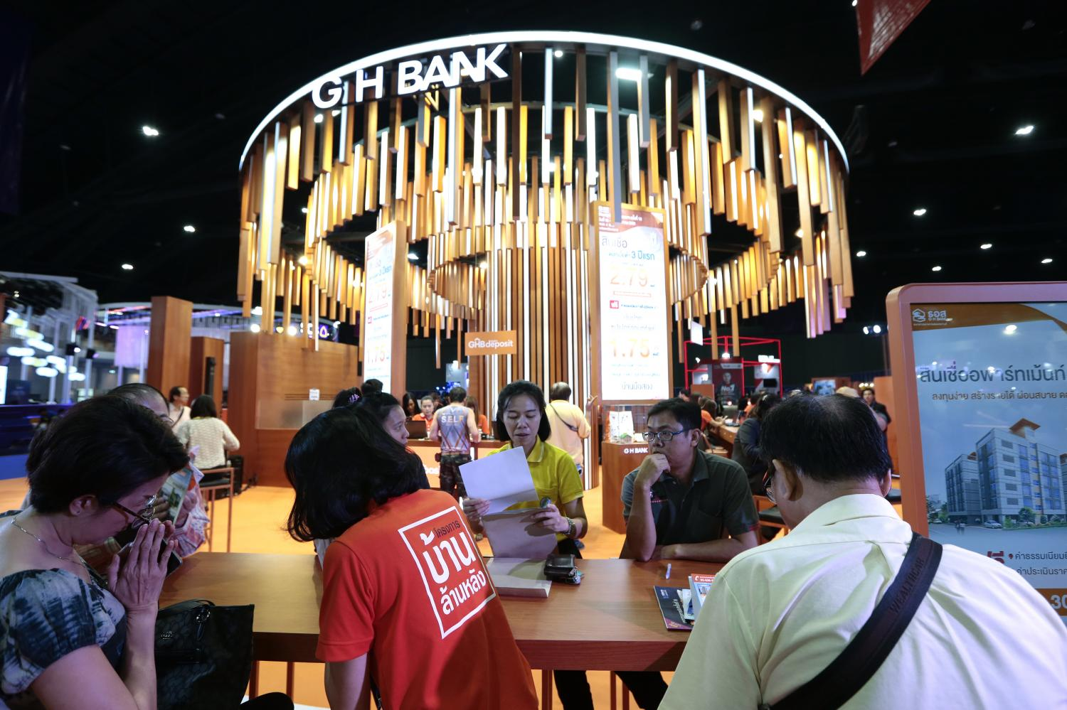 Visitors peruse housing loans at the GH Bank booth at Money Expo 2019.(Photo by Patipat Janthong)