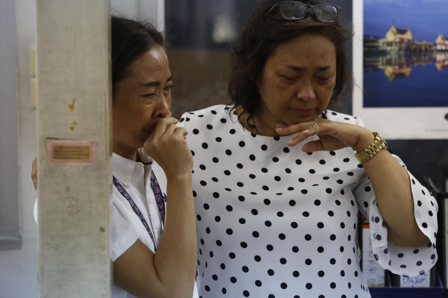 Staff of the Business Organisation of the Office of the Welfare Promotion Commission for Teachers and Educational Personnel cry after learning they have been laid off.  photos by Pornprom Satrabhaya