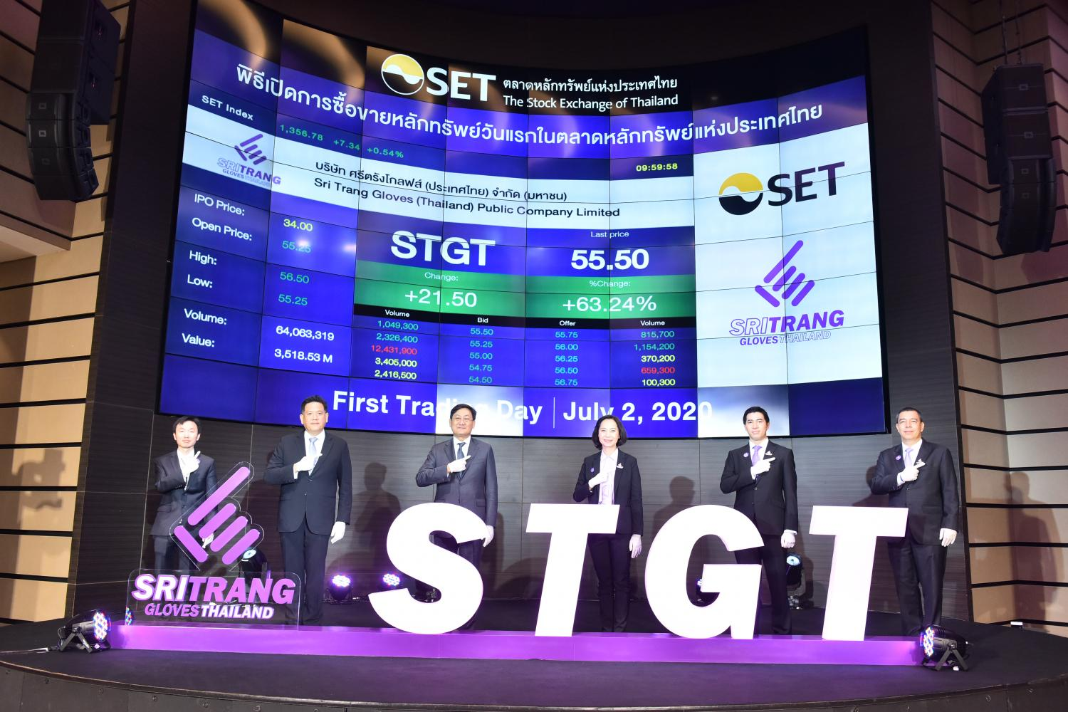 Ms Jarinya (centre right) and SET president Pakorn Peetathawatchai (centre left) share the SET stage on STGT's first day of trading.