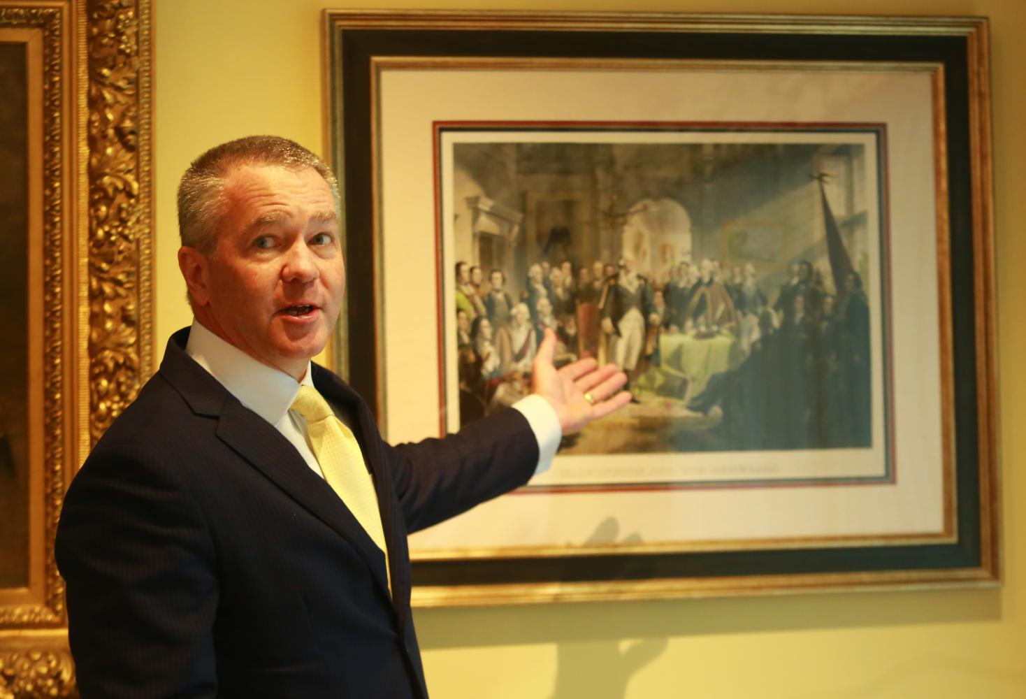 US Ambassador to Thailand, Michael George DeSombre, gestures toward a military painting — 'Washington and His Generals' — which shows General George Washington's farewell to his troops at Fraunces Tavern, New York City in 1783.(Photos: Somchai Poomlard)