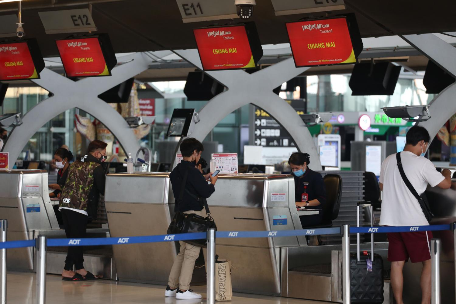 Passengers check in at Thai Vietjet's counter for a Chiang Mai-bound flight from Suvarnabhumi airport.