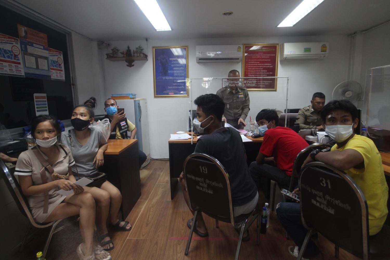 Five injured teenagers meet Samrong Tai police investigators on Monday to give testimony.
