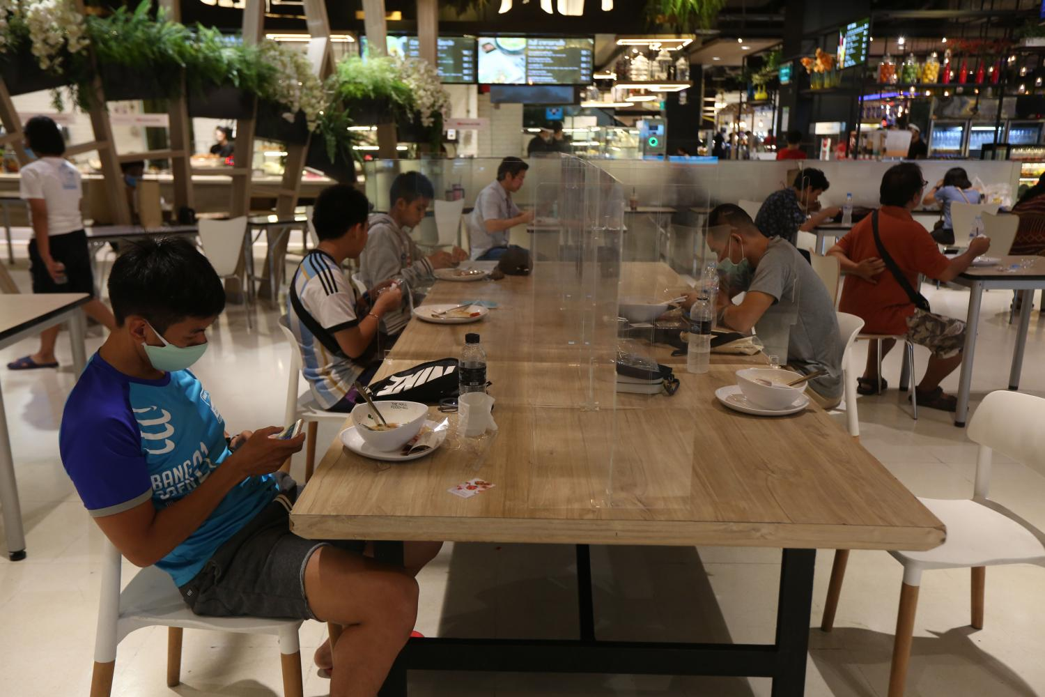 Diners at a food court in a Bangkok mall keep to social distancing.Varuth Hirunyatheb