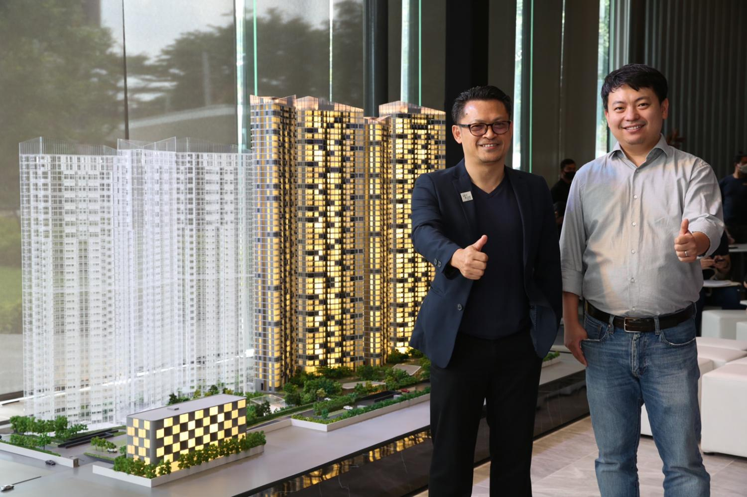 Yan Zhu, right, project director of Skyrise Avenue Sukhumvit 64, Risland Thailand, and Mr Kasemsak promote the new condo scheduled to launch next month. Separate facilities have been designed for foreigners and Thais.