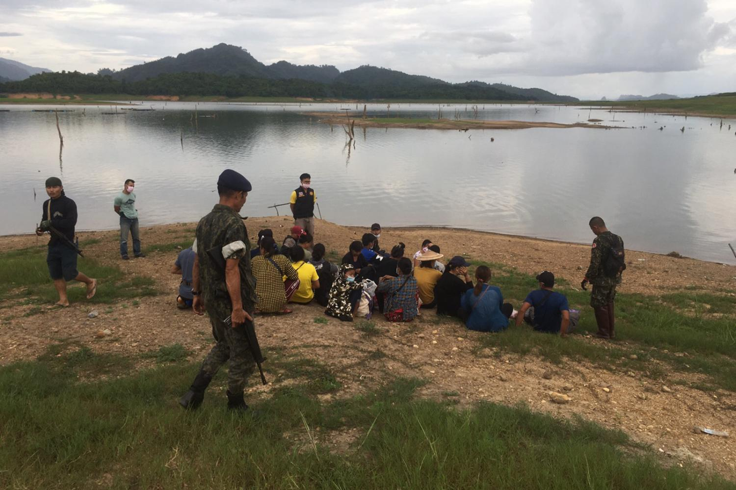 the great fisherman con: A file photo taken last week in which territorial defence volunteers posing as fishermen nabbed a group of 18 Myanmar nationals and a Thai helper as they illegally entered the kingdom in Sangkhla Buri of Kanchanaburi.