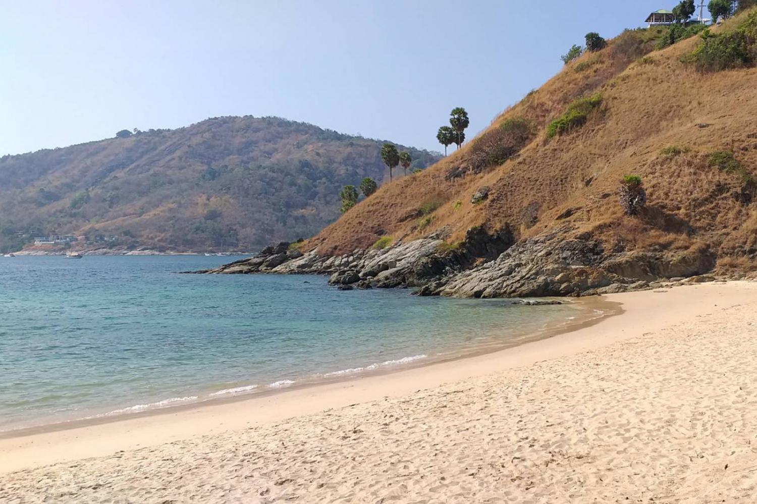 An empty beach emblematic of the costly slump in Phuket's tourism industry since the onset of the Covid-19 crisis in the country early this year.  Achadtaya Chuenniran